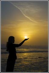 Holding the sun (Fstop Mathai) Tags: sunset sea india beach silhouette yellow nikon kerala veli trivandrum d60 1855mmvr kochuveli