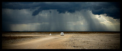 Mostly clear with light showers (jcross70) Tags: africa storm rain desert panoramic namibia etosha
