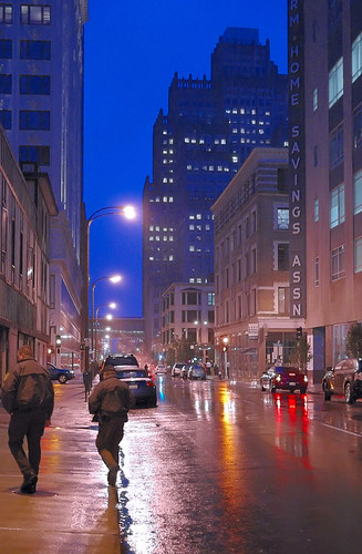 Policemen, in downtown Saint Louis, Missouri, USA - at dusk in the rain