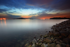 For the mind disturbed, the still beauty of dawn is nature's finest balm (J.^2) Tags: longexposure light sea cloud beach water rock stone sunrise canon dawn twilight singapore streak punggol milky j2 jiangjiang digitalblending 400d jsquare