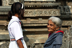 "a conversation between the past and the future (vbsuresh) Tags: school red woman india white black art girl beautiful architecture female work hair outside kid amazing ruins uniform sitting crafts praying skirt covered temples designs karnataka saree wondering sculptures carvings marvelous levels dynasty belur soapstone skill intricate halebeedu ""old hoysala stone"" band"" ""hair 40d lady"" ""soap"