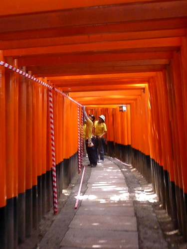 Workers prepping the torii for festival