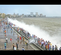 High Tide, Marine Drive, Mumbai - India ( Rizwan Mithawala) Tags: city sea people india beach water rain asia picnic cityscape flood rainy monsoon promenade bombay mumbai hightide chowpatty marinedrive arabiansea rizwan narimanpoint canonpowershota460 rizwanmithawala mithawala