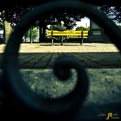 Snailed bench (Julien Ratel ( Jll Jnsson )) Tags: street city people streetart man yellow jaune grenoble canon fence bench square bravo colours view couleurs group snail photographers sigma cobblestone urbanexploration photowalk hugs rue groupe escargot saintlaurent ville banc homme association carr azulejos pav assoc barrire 2470f28 bisous photowalkers eos40d julienratel julienratelphotography blueju focusgrenoble grenowalk balladephoto grenews snailfunk