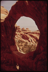 Double O Arch, One of Many Windows Carved Into Vertical Redrock by Centuries of Erosion, 05/1972 (The U.S. National Archives) Tags: archesnationalpark environmentalprotectionagency doubleoarch documerica usnationalarchives nara:arcid=545563