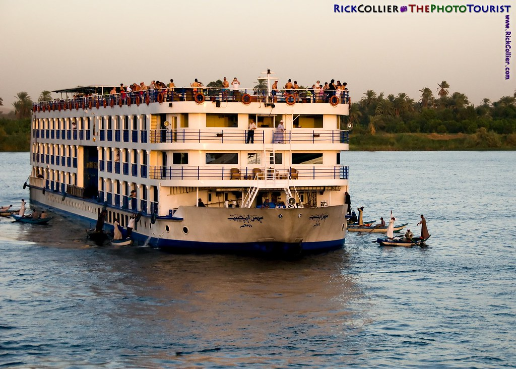 Merchants in small boats approach to sell souvenirs to the tourists onboard when the cruise ships stop to transit the locks at Esna Dam, on the Nile River in southern Egypt.