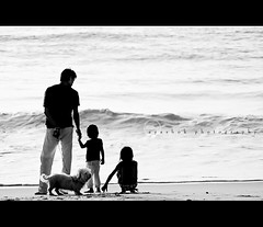 The Pursuit of Happyness (ayashok photography) Tags: family girls bw dog playing man guy kids sunrise blackwhite nikon madras watching dude marinabeach chennai nikkor70300mm nikonstunninggallery ayashok nikond300
