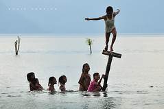 Jump into the Lake ( DocBudie) Tags: blue nature indonesia jump nikon village traditional flash cheer kampung joyful tpc humaninterest budaya batak humanist laketoba rurallife younggirls sb800 cheerfulness pulausamosir samosirisland lompat kidslife tourismdestination northsumatra nikkor18200mm danautoba sumaterautara pangururan liveview strobish volcanolake d300s childrenlife batakculture tanahbatak luarbiasaphotography nikond300s batakland tujuanwisata kabupatensamosir kehidupandesa budayabatak visitindonesia2009 visitlaketoba2010 tobaphotographerclub tobaphotographer tobaguide sumatraphotographer
