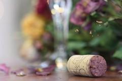 Bokeh bouquet (Nancy Rose) Tags: flowers roses blur petals wine bokeh cork glas