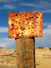 OK, whatever you say. (rovingmagpie) Tags: newmexico rust rusty bulletholes herrera top20nm canoncito keepgateclosed