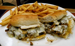 philly cheesesteak and fries (Scorpions and Centaurs) Tags: food dinner lunch restaurant yummy sub tasty plate frenchfries sandwich meat delicious meal dining chilis phillycheesesteak