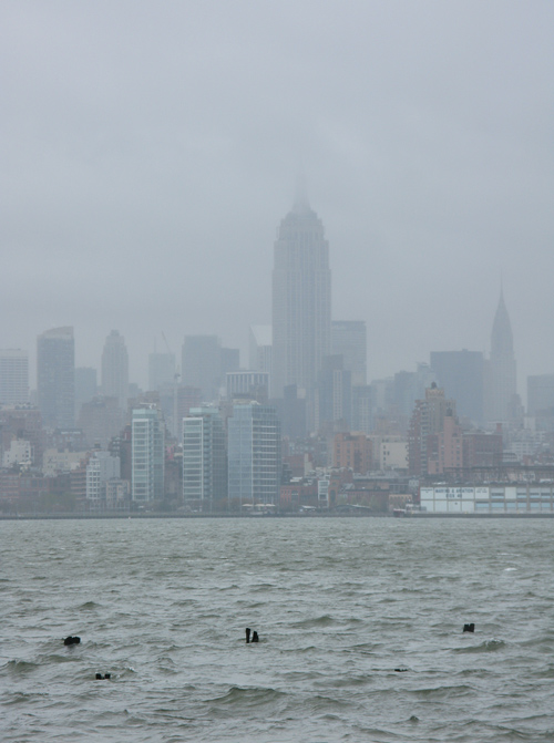 waves on the Hudson River and the Empire State Building scrapes the sky, Manhattan, NYC