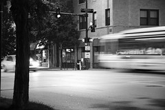 Rushing by... (-Tripp-) Tags: city urban bw chicago bus illinois cta publictransportation masstransit lincolnsquare ravenswood chicagotransitauthority larwarance