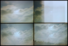 adventures into low-fidelity 1 (miemo) Tags: sky sun film broken clouds 35mm lomo actionsampler damaged expired