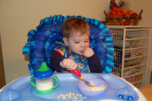 Feeding himself with a spoon 1