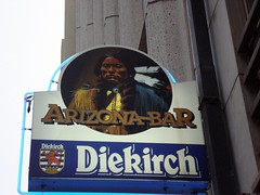 Huh? (sycamorepictures) Tags: sign bar advertising indian nativeamerican luxembourg businesssign diekirch arizonabar sycamorestirrings