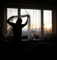 love to look out (.nevara) Tags: light sunset portrait sky orange woman cloud sun house black me window glass girl silhouette yellow lady female sunrise j evening looking sundown curtain atmosphere livingroom vase cinematic