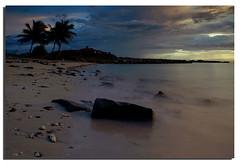The Beach (Nora Carol) Tags: sunset beach rocks waves sony palmtrees slowshutter kotakinabalu a200 batu pantai pasir malaysianphotographer suterahabour noracarol sabahanphotographer landscapephotographerfromsabah womanlandscapephotographer womaninphotography