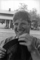 Hat trick (Magnus Bergström) Tags: portrait film smile hat analog 35mm kodak sweden teeth trix cx 400tx sl 400 135 3000 2009 chinon värmland kodaktrix400 ekshärad revueflex thogen00