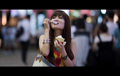 Sweet and Sweeter   (James Yeung) Tags: cute girl beautiful hongkong pretty candid icecream streetphoto cinematic ef135mmf2l canon5dmkii lifeinsevenpages