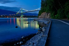 Stanley Park Seawall (Grant Mattice Photography) Tags: ocean bridge blue canada mountains beach water night vancouver reflections twilight marine rocks bc dusk britishcolumbia seawall stanleypark nightscene lionsgatebridge westcoast d300 longexsposure concordians nikoncanada summer2009 grantmatticeimages flikrcanada
