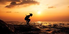 TD: Jump To The Sun (rasenkantenstein) Tags: ocean sunset sea cloud sun reflection art water rock japan set clouds reflections landscape japanese jump warm pacific action horizon atmosphere kagoshima yakushima setting prefecture tone silhoutte