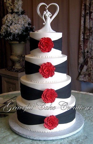 Elegant White and Black Wedding Cake with Red Roses - a photo on ...