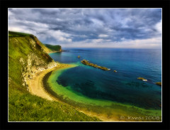 Man o War (JKmedia) Tags: uk blue sea england sky cliff green grass clouds coast rocks south erosion explore dorset headland lulworth manowar cubism durdledoor mywinners anawesomeshot canoneos40d jkmedia pregamewinner