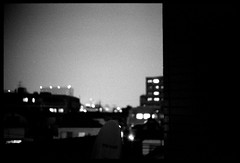 (gullevek) Tags: light sky blackandwhite building film japan night dark lights tokyo   lonely ilford iso1600 depressing housebuilding viewfromwindow   ilforddelta3200pro  epsongtx900 voigtlndernoktonclassic40mmf14mc voigtlnderbessar2a