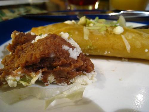 My portion of Tacos Doradosde with Refried Beans