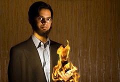 Peter Petrelli (C H O I) Tags: lighting portrait photoshop fire glasses model nikon hand d70 flash creative flame wireless heroes pyro flaming sb800
