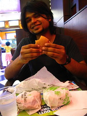 three burgers. all his. yep. (Premshree Pillai) Tags: people food mall burger mcdonalds bombay mumbai vinod goregaon indiasep09 foodmurderer mallgeneration