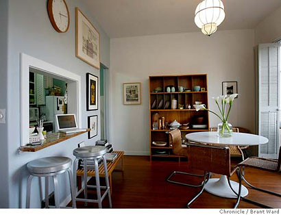 Clean, simple dining area + pale green wall + Saarinen table