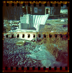 Sprocket holes from 2 rolls of 35mm film in a 120 camera (jstancel) Tags: atlanta 35mm georgia book iso200 holga chair fuji urbandecay toycamera sprocketholes allrightsreserved overlapping35mm