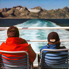 Leaving the Islands (JurassicParkCamera) Tags: ocean travel blue red sea vacation sky people mountain snow norway bar landscape island track ship wind yes coat tail watch oct stock cap polar lofoten chear
