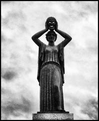 The Mask (namuit) Tags: madrid sky cloud white black statue clouds nuvole nuvola mask cielo statua spagna maschera nuvoloso