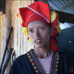 Red Dao Woman standing in the doorway (NaPix -- (Time out)) Tags: china red portrait woman 6x6 square asia expression vietnam ethnic dao minority emotions yao z   napix yo