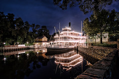 Liberty Belle Reflection (~Life by the Drop~) Tags: park vacation reflection tourism water night river wonder photography mirror orlando still nikon quiet florida getaway magic wideangle tourist disney special professional disneyworld nightime riverboat theme destination fullframe waltdisneyworld fx magical magickingdom attraction waltdisney dvc libertysquare scl paddlewheel paddlewheeler uwa sigma1224 orlandoflorida gdad ultrawideangle libertybelle wheredreamscometrue orlandothemepark disneythemepark yearofamilliondreams d700 waltdisneyworldorlando nikond700 wherethemagiclives disneypassholder disneyyourway