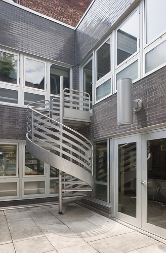 Quick vertical and horizontal circulation was ensured by providing several corridors for traversing the space, including a spiral stair in the rear courtyard. ()