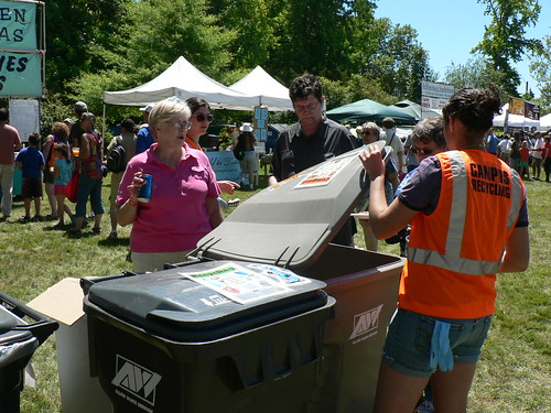 A Green Team volunteer helps festival attendees sort at the 2010 festival.