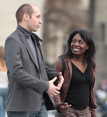 as we walk (V) (qmusaget) Tags: street portrait paris france couple candid streetphotography smiley doubleportrait naturalness eos40d 1352l11000f2iso500 noninteractivenonparticipating