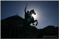 The First Knight (krisdecurtis) Tags: italy horse sun silhouette statue backlight canon dark spectacular interestingness interesting italia 300d campania canon300d kris napoli naples knight statua cavallo 2009 controluce masterpiece cavaliere marvels piazzadelplebiscito maddaloni plebiscito napule meraviglie plebiscitosquare krisdecurtis basilicadisfrancescodipaola carloiiidiborbone