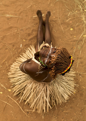 Tharaka tribe girl with a grass skirt - Kenya