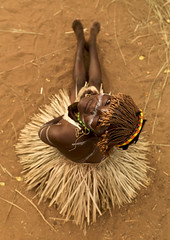 Tharaka tribe girl with a grass skirt - Kenya (Eric Lafforgue) Tags: africa girl dress kenya culture tribal wig sit tribes afrika jupe tradition tribe ethnic tribo afrique ethnology tribu eastafrica 1325 qunia lafforgue tharaka ethnie abigfave  qunia    kea    a