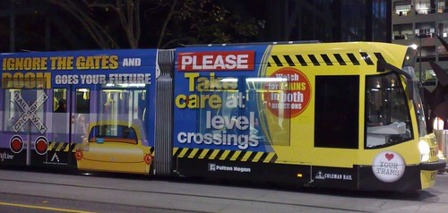 Rail safety advertising on a tram