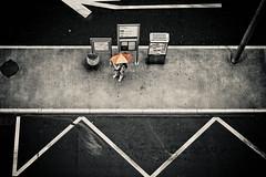 L'humain, l'infini petit (Gabriel Asper) Tags: street people bus gabriel texture les umbrella de landscape switzerland la photo alone suisse geneva geneve photos d g parking picture pluie des route r pr p 24 paysage rue pict genve 2009 personne tpg dans aout 43 parapluie ambiance jeunes genf asper acacias attendre attend suiss gasper gabiche gabicheminimal