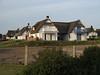 Viking homes (dididumm) Tags: roof house modern germany viking schleswigholstein thatched wikinger reetdach pelzerhaken