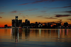 Detroit's Skyline (playjust) Tags: park blue orange water buildings lights belleisle stillwaters refelections stillclouds