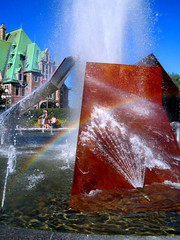 Colorful Angles (catchesthelight) Tags: trip travel summer sculpture canada water fountain station train rainbow rail bluesky copper quebeccity frontenac