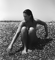la mer.....# 4 (manuel cristaldi) Tags: shadow sea blackandwhite bw italy woman sun film 35mm blackwhite noiretblanc stones trix dream earring august pebbles beautifulwomen sicily relatives summertime minox minox35gt lesdeuxmagots  mostexcellent favorites50 libertango artandphotography manuelcristaldi portrait